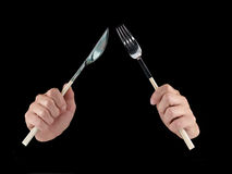Womans hands holding cutlery. Stock Images