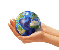 Womans hands holding the Earth globe. On white background. Clipping path included Royalty Free Stock Images