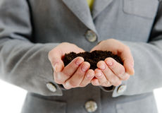 Womans hands holding a handful of earth Stock Photos