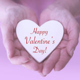 Womans hands holding heart with words Happy Valentines Day stock photos