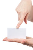 Womans hands holding and pointing empty card Stock Image