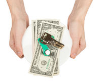 Womans hands holding saucer with cash and keys Royalty Free Stock Images