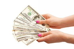 Woman's hands holding 100 US dollar banknotes Stock Photography