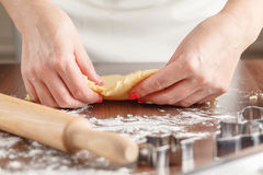 Womans hands making home made biscuits close up Royalty Free Stock Images