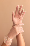 Womans hands modeling vintage lace gloves Stock Photos