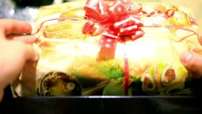 Womans hands open box with Christmas magic gift. stock video footage