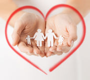 Womans hands with paper man family Stock Images