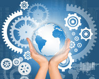 Womans hands with planet and cogs. Womans hands with planet on abstract background with cog wheels Stock Photo
