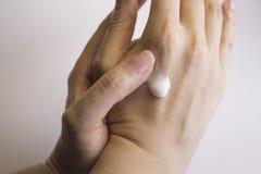 Womans hands self massage Stock Photo