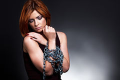 Womans hands tied together with chains Stock Images