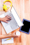 Womans hands typing on a laptop Royalty Free Stock Photo