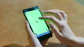 Womans hands using a Smart phone Touchscreen CHROMA KEY Close-up , Fingers make gestures touching and swiping the screen. Business woman using a Smart phone stock video footage