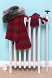 Womans hat scarf and gloves drying on a radiator Royalty Free Stock Photography