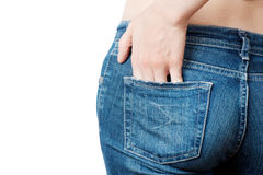 Womans jeans backside. Shot of young woman behind in worn out jeans Royalty Free Stock Photo