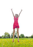 Womans joyful leap in buttercup meadow Stock Photo