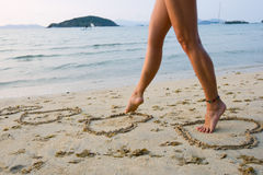 Womans legs on beach Stock Photo