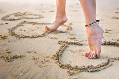 Womans legs on beach Stock Photography
