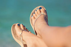 Womans legs at beach in summer Stock Photo