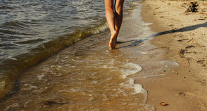 Womans legs closeup in the sea near the beach Royalty Free Stock Images