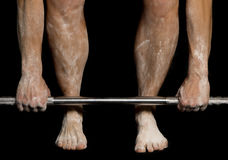 Womans legs and hands with powder on them holding bar down Royalty Free Stock Photos