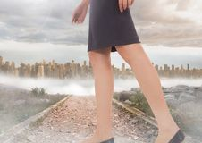 Womans legs Walking on path near city Stock Images