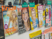 Womans magazines in germany. Womens magazines in a german newsstand with some selective focus Stock Photos