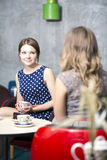 Womans make dialogue and drinking hot coffee Royalty Free Stock Photography