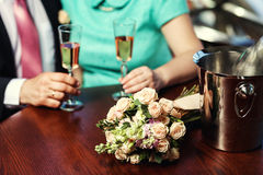 Womans and mans wedding hands with glasses.Happy newlyweds coupl Royalty Free Stock Photography
