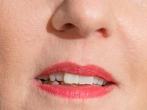Womans mouth with red lipstick royalty free stock photo