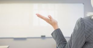 Womans open hand over whiteboard royalty free stock image
