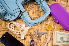 Womans purse light blue color lying flat with Stock Photos