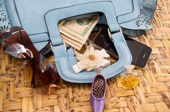 Womans purse light blue color lying flat with Royalty Free Stock Images