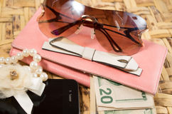 Womans purse pink color lying flat with Stock Photos