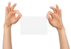 Womans right hand holding blank paper with fingers Stock Image