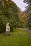 Womans Sculpture in the Autumn old St.Peterburg's Park Royalty Free Stock Image