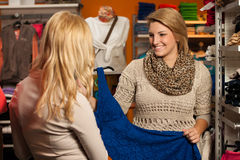 Womans shopping - Two girls in a clothes shop choo Stock Photography