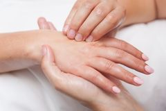 Womans in spa salon massage therapy and beauty treatments Royalty Free Stock Images