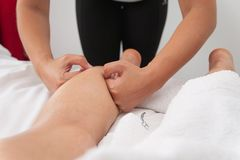 Womans in spa salon massage therapy and beauty treatments Stock Images