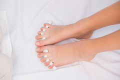 Womans toes separated by toe separators Stock Image
