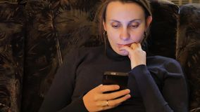 Womans using mobile phone touchscreen. Woman close-up hands using mobile phone stock video footage