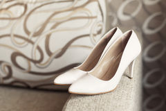 Womans white wedding leather shoes Royalty Free Stock Photo