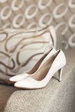 Womans white wedding leather shoes Royalty Free Stock Photos