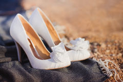 Womans white wedding shoes. Womans white high heel wedding shoes Royalty Free Stock Photography