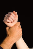 Womans wrist held by man Royalty Free Stock Images
