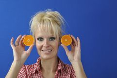 Womanwith a clementine Royalty Free Stock Photography