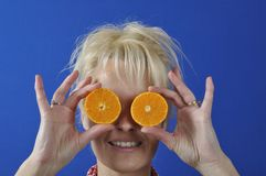 Womanwith a clementine Stock Image