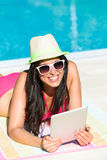 Womanwith tablet reading on summer vacation Stock Photography