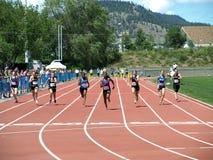 Women on 100 meters dash. KELOWNA, CANADA - Kalmakoff Jessica, MacKay Megan, Ryan Nishelle, Joyce Adele, Joyce Elisa, Biagi Anastaysia, Brown Ella, Lieschke Stock Photo
