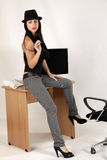 Women. Young women sitting on the desk Royalty Free Stock Photography