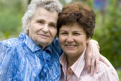 Women. Elderly woman with her daughter Stock Photo